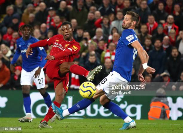 Georginio Wijnaldum of Liverpool scores his team's fifth goal during the Premier League match between Liverpool FC and Everton FC at Anfield on...