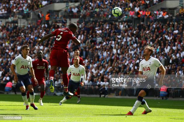 Georginio Wijnaldum of Liverpool scores his team's first goal during the Premier League match between Tottenham Hotspur and Liverpool FC at Wembley...