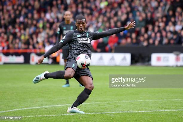Georginio Wijnaldum of Liverpool scores his team's first goal during the Premier League match between Sheffield United and Liverpool FC at Bramall...