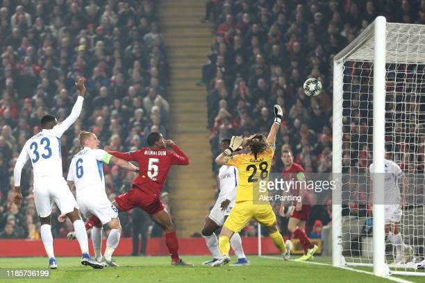 Georginio Wijnaldum of Liverpool scores his team's first goal during the UEFA Champions League group E match between Liverpool FC and KRC Genk at...