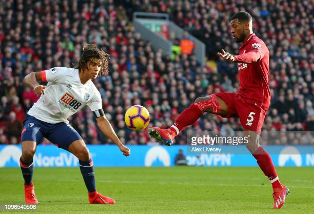 Georginio Wijnaldum of Liverpool scores his team's second goal under pressure from Nathan Ake of AFC Bournemouth during the Premier League match...