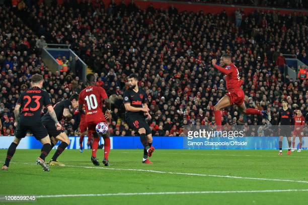 Georginio Wijnaldum of Liverpool scores the opening goal during the UEFA Champions League round of 16 second leg match between Liverpool FC and...