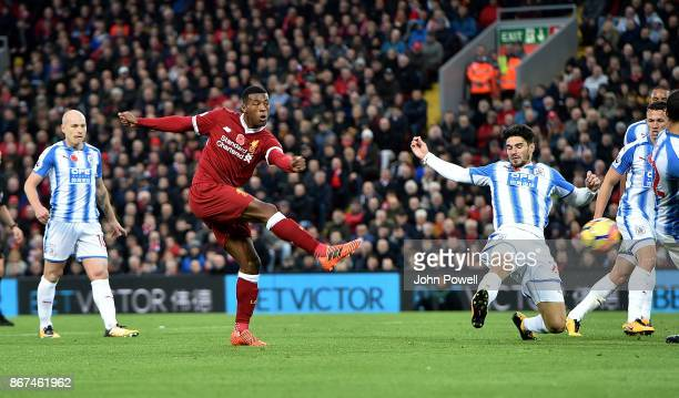 Georginio Wijnaldum of Liverpool scores the third goal during the Premier League match between Liverpool and Huddersfield Town at Anfield on October...