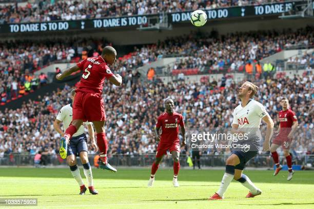 Georginio Wijnaldum of Liverpool scores their 1st goal during the Premier League match between Tottenham Hotspur and Liverpool FC at Wembley Stadium...