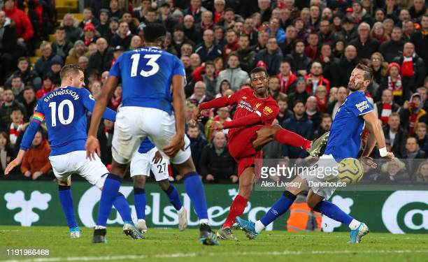 Georginio Wijnaldum of Liverpool scores their fifth goal during the Premier League match between Liverpool FC and Everton FC at Anfield on December...