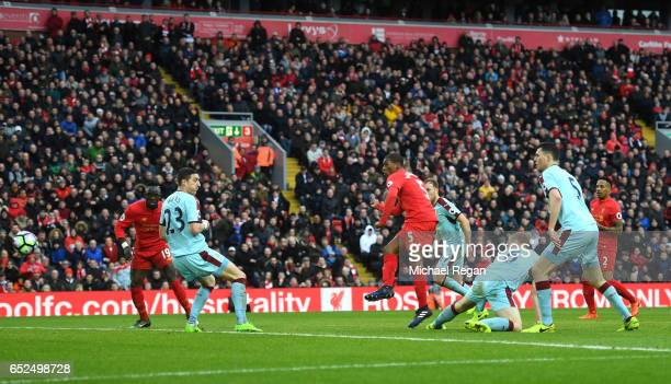 Georginio Wijnaldum of Liverpool scores their first and equalising goal during the Premier League match between Liverpool and Burnley at Anfield on...