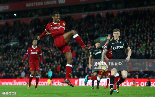 Georginio Wijnaldum of Liverpool shoot at goal during the Premier League match between Liverpool and Swansea City at Anfield on December 26 2017 in...