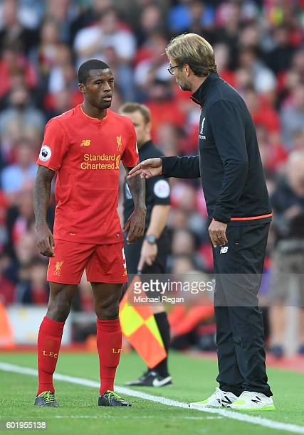 Georginio Wijnaldum of Liverpool speaks to Jurgen Klopp Manager of Liverpool during the Premier League match between Liverpool and Leicester City at...