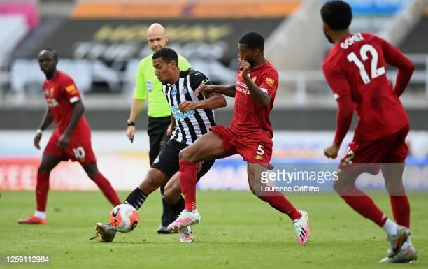 Georginio Wijnaldum of Liverpool tackles Isaac Hayden of Newcastle United during the Premier League match between Newcastle United and Liverpool FC...