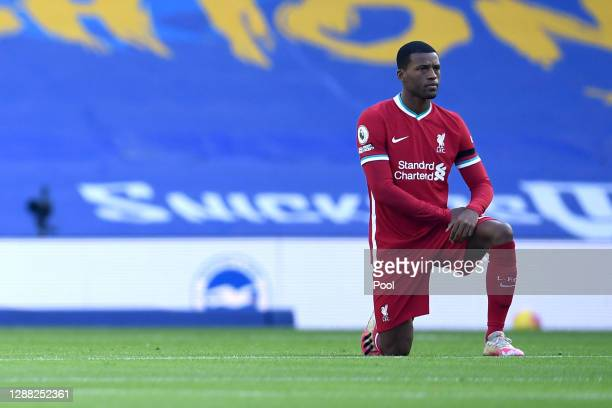 Georginio Wijnaldum of Liverpool takes a knee in support of the Black Lives Matter movement prior to the Premier League match between Brighton & Hove...