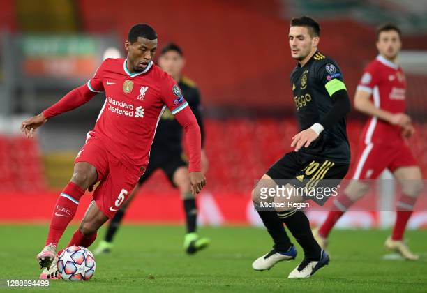 Georginio Wijnaldum of Liverpool takes on Dusan Tadic of Ajax during the UEFA Champions League Group D stage match between Liverpool FC and Ajax...
