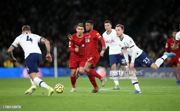 Georginio Wijnaldum of Liverpool takes the ball away from Christian Eriksen of Tottenham during the Premier League match between Tottenham Hotspur...