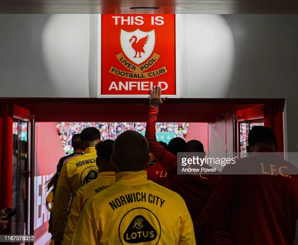 """Georginio Wijnaldum of Liverpool touching the """"This is Anfield"""" sign before the Premier League match between Liverpool FC and Norwich City at Anfield..."""