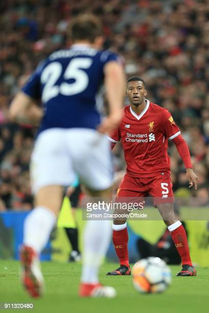 Georginio Wijnaldum of Liverpool watches as Craig Dawson of West Brom clears the ball during The Emirates FA Cup Fourth Round match between Liverpool...