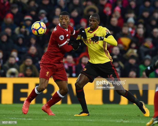 Georginio Wijnaldum of Liverpool with Adboulaye Doucoure Watford during the Premier League match between Liverpool and Watford at Anfield on March 17...