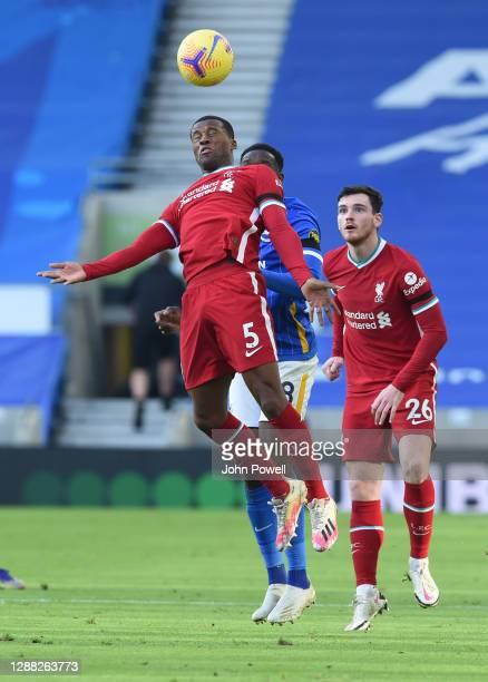Georginio Wijnaldum of Liverpool with Brighton & Hove Albion's Danny Welbeck during the Premier League match between Brighton & Hove Albion and...