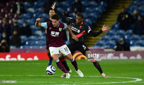 Georginio Wijnaldum of Liverpool with Burnley's Ashley Westwood during the Premier League match between Burnley and Liverpool at Turf Moor on May 19,...