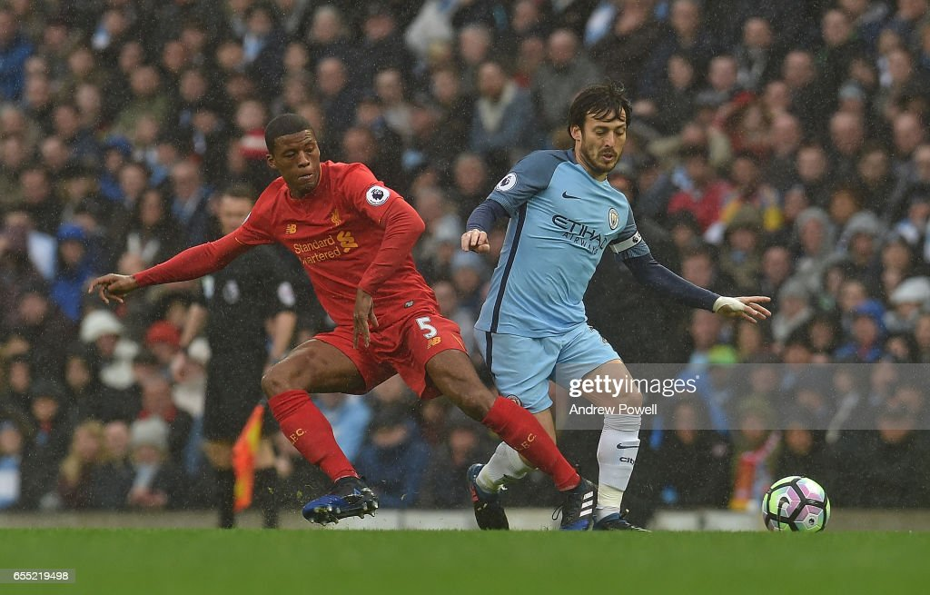 Georginio Wijnaldum of Liverpool with David Silva of Man City during the Premier League match between Manchester City and Liverpool at Etihad Stadium on March 19, 2017 in Manchester, England.