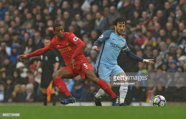 Georginio Wijnaldum of Liverpool with David Silva of Man City during the Premier League match between Manchester City and Liverpool at Etihad Stadium...