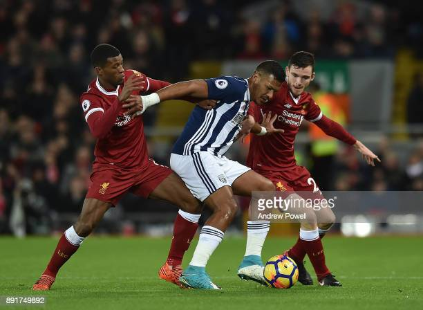 Georginio Wijnaldum of Liverpool with Hal RobsonKanu of West Brom during the Premier League match between Liverpool and West Bromwich Albion at...