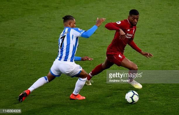 Georginio Wijnaldum of Liverpool with Juninho Bacuna of HUddersfield during the Premier League match between Liverpool FC and Huddersfield Town at...