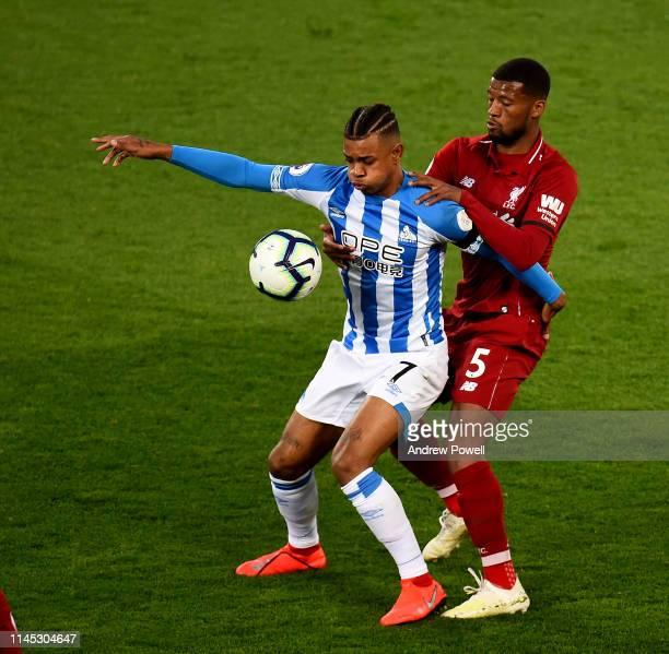 Georginio Wijnaldum of Liverpool with Juninho Bacuna of Huddersfield Town during the Premier League match between Liverpool FC and Huddersfield Town...