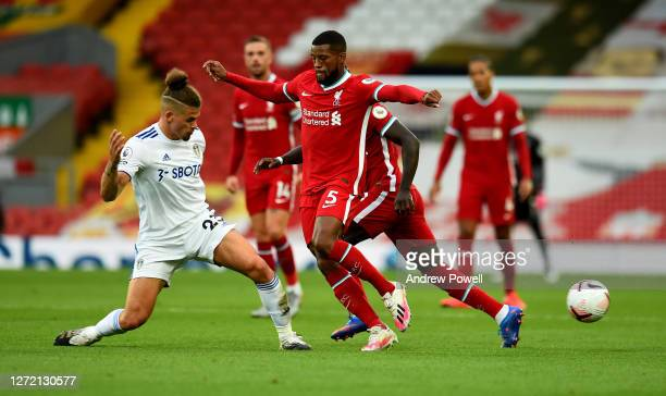 Georginio Wijnaldum of Liverpool with Kalvin Phillips of Leeds United during the Premier League match between Liverpool and Leeds United at Anfield...
