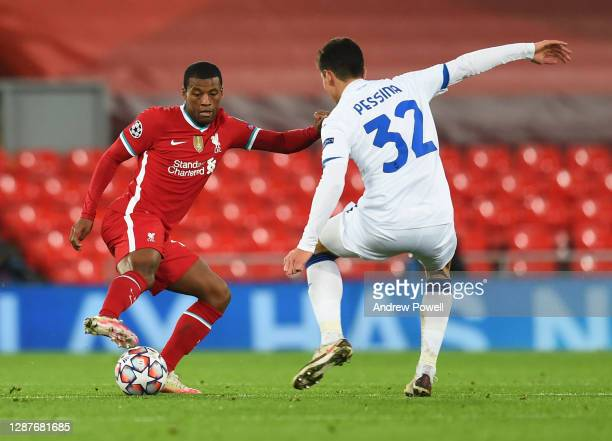 Georginio Wijnaldum of Liverpool with Matteo Pessina of Atalanta during the UEFA Champions League Group D stage match between Liverpool FC and...