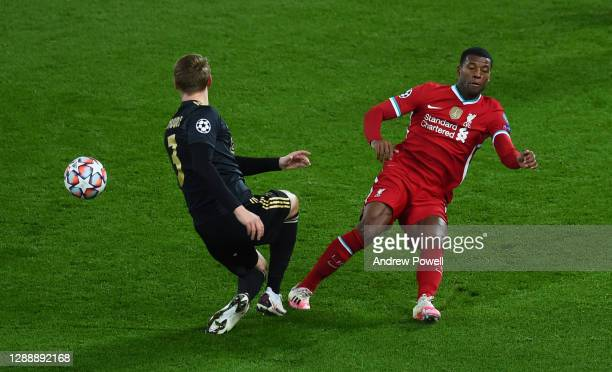 Georginio Wijnaldum of Liverpool with Perr Schuurs of Ajax during the UEFA Champions League Group D stage match between Liverpool FC and Ajax...