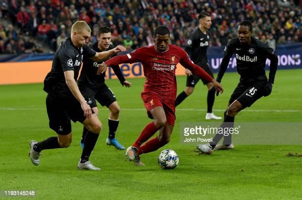 Georginio Wijnaldum of Liverpool with Rasmus Kristensen of RB Salzburg during the UEFA Champions League group E match between RB Salzburg and...