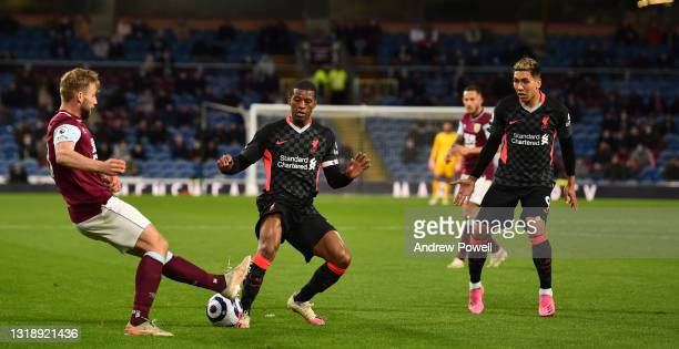Georginio Wijnaldum of Liverpool with Roberto Firmino of Liverpool during the Premier League match between Burnley and Liverpool at Turf Moor on May...