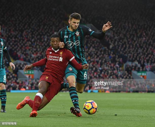 Georginio Wijnaldum of Liverpool with Wesley Hoedt of Southampton during the Premier League match between Liverpool and Southampton at Anfield on...