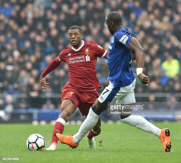 Georginio Wijnaldum of Liverpool with Yannick Bolasie of Everton during the Premier League match between Everton and Liverpool at Goodison Park on...