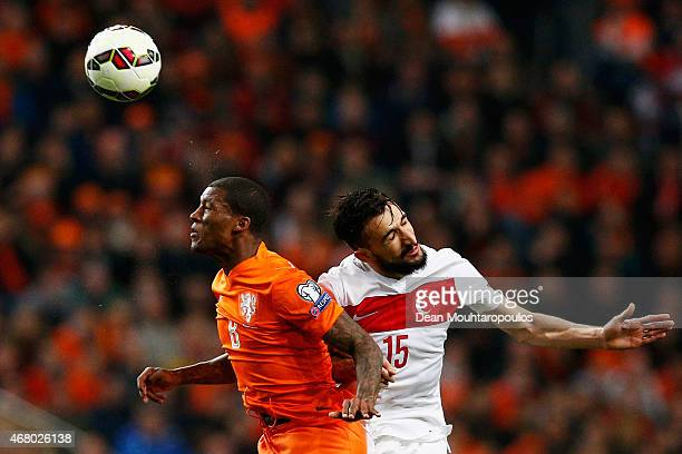 Georginio Wijnaldum of Netherlands and Mehmet Topal of Turkey battle for the ball during the UEFA EURO 2016 qualifier match bewteen the Netherlands...