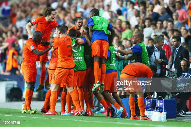 Georginio Wijnaldum of Netherlands celebrates his team's second goal with team mates during the UEFA European Under 21 Championship match between...