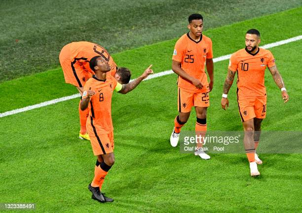 Georginio Wijnaldum of Netherlands celebrates with Jurrien Timber and Memphis Depay after scoring their side's first goal during the UEFA Euro 2020...