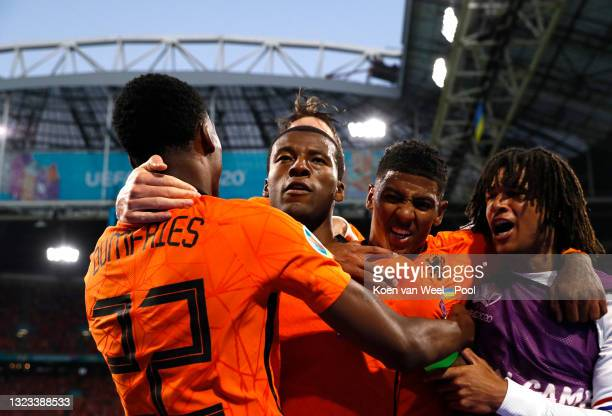 Georginio Wijnaldum of Netherlands celebrates with teammates after scoring their side's first goal during the UEFA Euro 2020 Championship Group C...