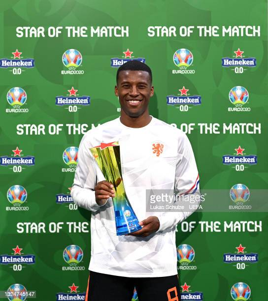 """Georginio Wijnaldum of Netherlands poses for a photograph with the Heineken """"Star of the Match"""" award after the UEFA Euro 2020 Championship Group C..."""