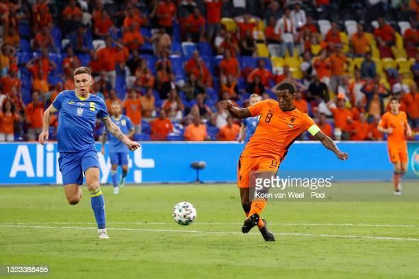 Georginio Wijnaldum of Netherlands scores their side's first goal whilst under pressure from Serhiy Sydorchuk of Ukraine during the UEFA Euro 2020...