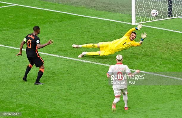 Georginio Wijnaldum of Netherlands scores their side's third goal past Stole Dimitrievski of North Macedonia during the UEFA Euro 2020 Championship...