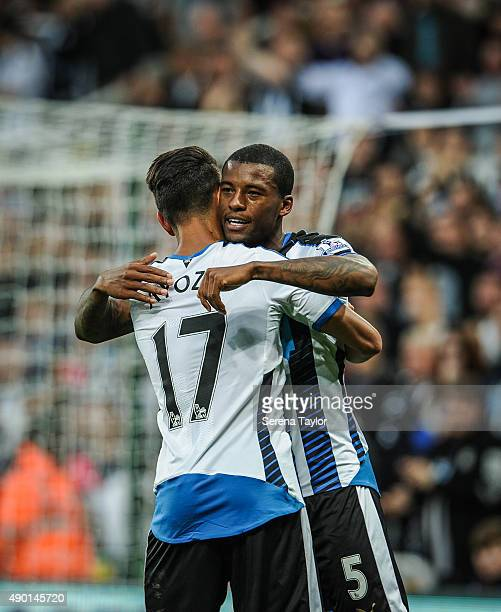 Georginio Wijnaldum of Newcastle celebrates with Ayoze Perez after scoring their second goal during the Barclays Premier League match between...