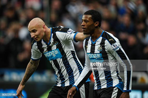 Georginio Wijnaldum of Newcastle celebrates with teammate Jonjo Shelvey after scoring their second goal during the Barclays Premier League match...
