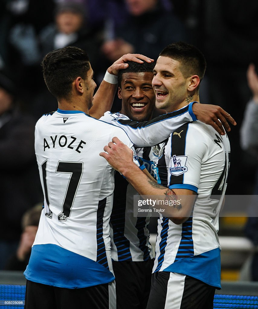Georginio Wijnaldum (C) of Newcastle celebrates with teammates Aleksandar Mitrovic (R) and Ayoze Perez (L) after scoring their second goal during the Barclays Premier League match between Newcastle United and West Ham United at St.James' Park on January 16, 2016, in Newcastle upon Tyne, England.