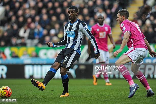 Georginio Wijnaldum of Newcastle passes the ball whilst being pursued by Dan Gosling of AFC Bournemouth during the Premier League Match between...