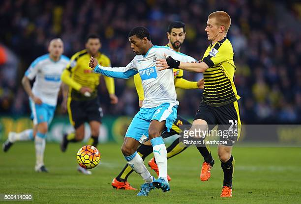 Georginio Wijnaldum of Newcastle United and Ben Watson of Watford compete for the ball during the Barclays Premier League match between Watford and...
