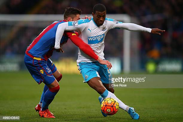 Georginio Wijnaldum of Newcastle United and Joel Ward of Crystal Palace compete for the ball during the Barclays Premier League match between Crystal...