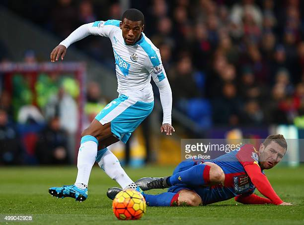 Georginio Wijnaldum of Newcastle United and Yohan Cabaye of Crystal Palace compete for the ball during the Barclays Premier League match between...