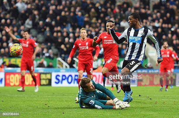 Georginio Wijnaldum of Newcastle United beats goalkeeper Simon Mignolet of Liverpool as he scores their second goal during the Barclays Premier...