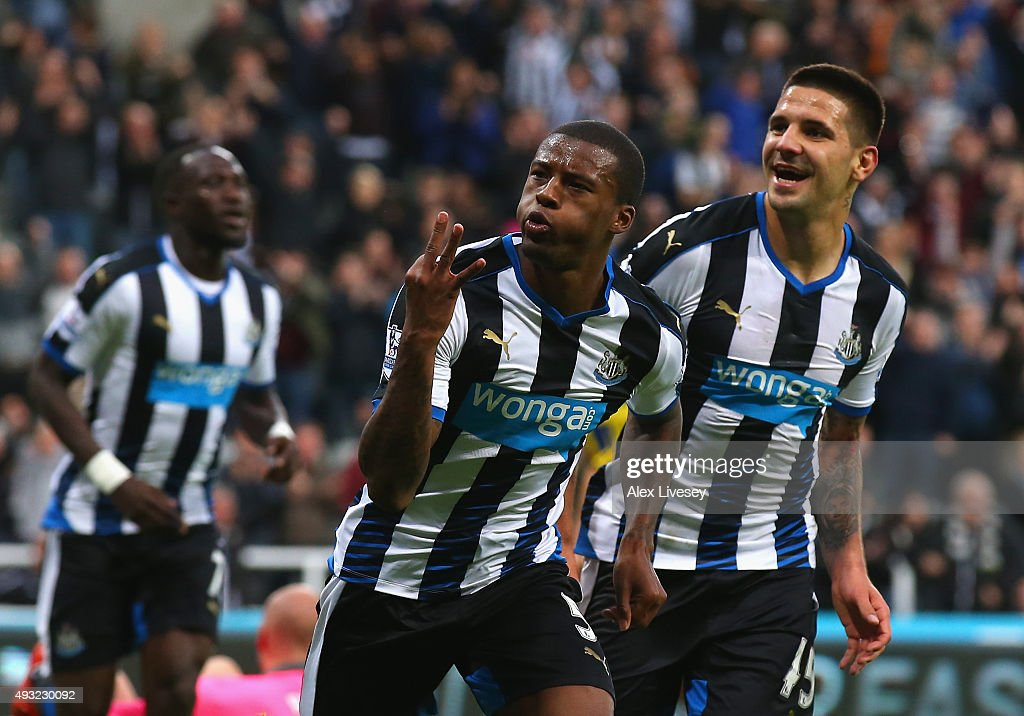 Georginio Wijnaldum of Newcastle United celebrates as he scores their their fifth goal to complete his hat trick during the Barclays Premier League match between Newcastle United and Norwich City at St James' Park on October 18, 2015 in Newcastle upon Tyne, England.