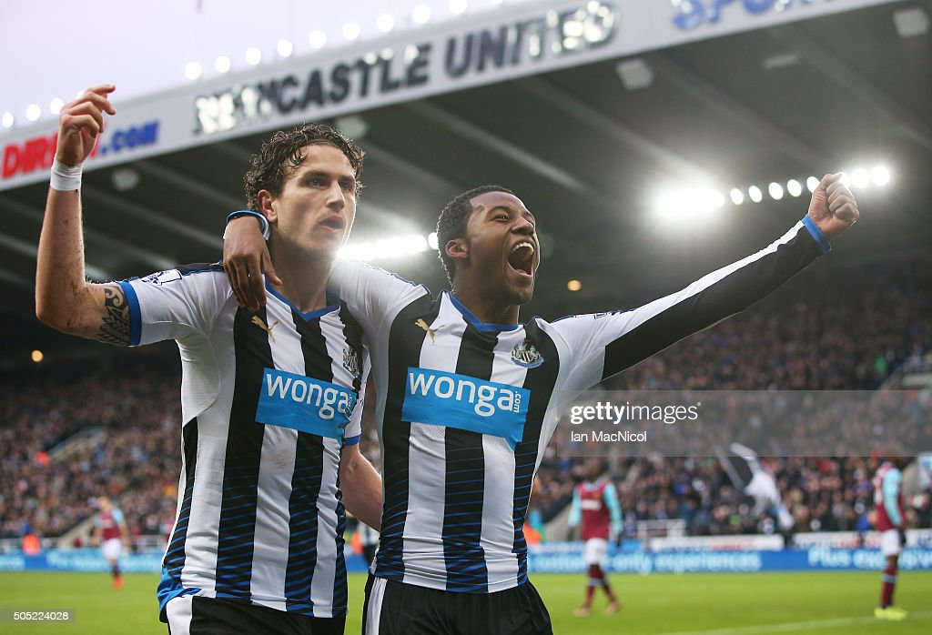 Georginio Wijnaldum (R) of Newcastle United celebrates scoring his team's second goal with his team mate Daryl Janmaat (L) during the Barclays Premier League match between Newcastle United and West Ham United at St. James' Park on January 16, 2016 in Newcastle, England.